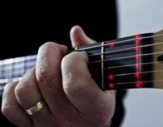The Fretlight lighted guitar learning system allows a player to light-up songs, over five thousand chords and scales patterns, and riffs right on the neck of the Fretlight guitar. The Fretlight connects to a PC or Mac and there are lessons, songs and interactive videos available which all light up the guitar.