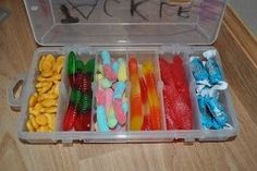 Tackle box filled with fishing themed treats. Father's day gift, for the fisherman in him, from the kids. Or for my adorable daughter Amelia who loves to fish for the ride to Canada.  Cute.