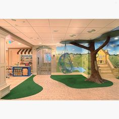 How cute is this playroom?! Complete with a police station, general store and a tree swingCredit to Gander Builders... - Home Decor For Kids And Interior Design Ideas for Children, Toddler Room Ideas For Boys And Girls