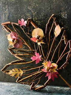 Autumn Leave               Look for ways to dress up store-bought decorating accessories. This leaf-shape twig accessory (so have to make) was embellished with fall leaves and acorns, which add color and texture to the purchased frame.