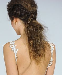 A braided, messy ponytail for the boho bride.