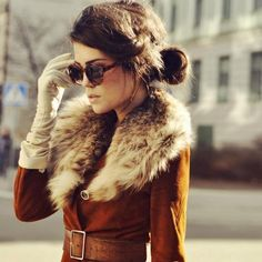 a nod to bygone era...love the fur trim coat, leather belt, long leather gloves and shades.