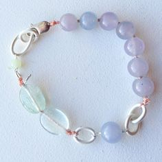 A personal favorite from my Etsy shop https://www.etsy.com/listing/259416775/crackled-mint-quartz-bracelet
