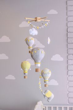 Gender Neutral Baby Mobile, Hot Air Balloon and Elephant, Travel Theme, Circus Nursery Decor, i80 by sunshineandvodka on Etsy https://www.etsy.com/listing/228306171/gender-neutral-baby-mobile-hot-air