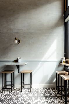 Love the plaster on the walls. The wainscot is Benjamin Moore Marina Gray. Design by Hannah Collins Design