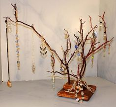 Jewelry Tree  Triple Branch Manzanita  960 by RedBarkDesigns, $37.00  I am so in love with mine, which i customized for my goodies