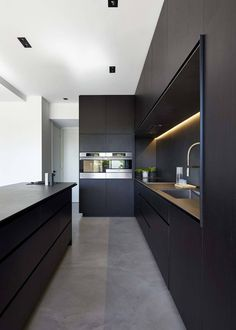 kitchen idea - M House is a minimalist house located in Melbourne, Australia, designed by DKO. The kitchen space features blacked out custom cabinetry with a black kitchen island that allows for seating and serving. Modern Kitchen Cabinets, Modern Kitchen Design, Interior Design Kitchen, Kitchen Furniture, New Kitchen, Kitchen Dining, Kitchen Ideas, Kitchen Designs, Kitchen Inspiration