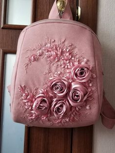 Ashen rose backpackribbons embroidered roses and dragonflies Ribbon Embroidery Tutorial, Embroidery Bags, Hand Embroidery Dress, Hand Embroidery Stitches, Silk Ribbon Embroidery, Embroidered Roses, Indian Embroidery, Bordado Floral, Bridesmaid Bags