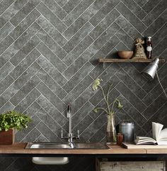 Use tile in a creative herringbone pattern to elevate a simple rectangular tile.