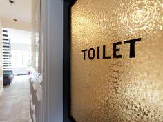 Toilet. Genevieve Gorder's bathroom door in her NYC Brownstone