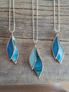 Hey, I found this really awesome Etsy listing at https://www.etsy.com/listing/570092074/turquoise-leaf-stained-glass-necklace #StainedGlassJewelry