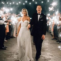 Sparkler exits are our favorite! Wedding dress @sarahseven | Photography @bethanysmallphoto | Bridal shop @thedresstheory #sparkler #sparklerexit #weddingexit #weddingchicks