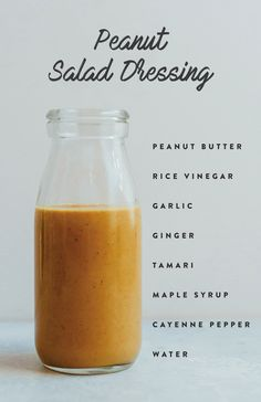 Peanut Salad Dressing with peanut butter, rice vinegar, garlic, ginger, tamari, maple syrup, cayenne pepper and water.