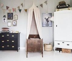 Kids room with antique bed and mix and match coloured furniture Kids room with antique bed and mix a