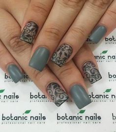 Dark gray matte and with touches of beautiful swirling patterns in black.