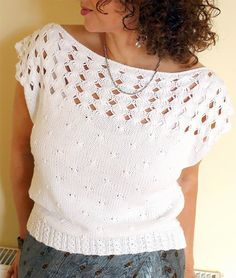 Knitting Pattern for Brigid's Cross Top - Boat-neck style top with dropped cap sleeves, Brigid's Cross Lace on the yoke, peppercorn pattern on the body, and eyelet cable ribbing at hem. Sport weight yarn. Designed by Coryna Blasko