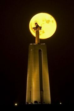 Cristo Rei statue - Full moon over Lisbon, Portugal - This is the same statue as the one in Rio, but smaller. Beautifully lit for the whole city to see.
