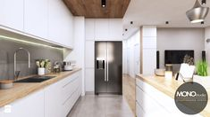 Jasna, ciepła kuchnia w nowoczesnym klimacie - zdjęcie od MONOstudio