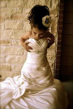 A picture of daughter in Mom's wedding gown