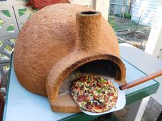 Pizza cooking in new pizza oven built from pumice-concrete or use refractory mix or perlite-vermiculite !