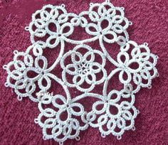 Beautiful Motif with pattern inked in different step-by-step pics. This is the center of a beautiful lacy doily !