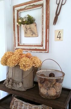 I love the upscale shabby chic look of this vignette.