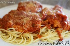 Crock Pot Chicken Parmesan!  This recipe tastes INCREDIBLE and is so easy to throw together!