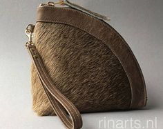 leather zipper pouch / Q-bag clutch / triangle bag in light brown cow hair on hide. Cow hair wristlet