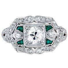 Circa 1920's ring with emeralds, at Brilliant Earth.