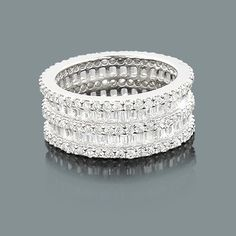 Designer Diamond Eternity Rings: This Round Baguette Band in 14K gold weighs approximately 8 grams and features 6.80 carats of sparkling diamonds. This diamond eternity ring is available in Platinum, 18k or 14k yellow, rose, white gold, various sizes, and can be customized with any color and quality diamonds. Price and description is for a ring in 14k gold and size 6. Please note: it will take us 3-5 business days to make this ring for you, so please plan accordingly. Please contact us at…