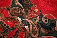 This is a photo from Int'l Quilt show in Houston 2008.  What stunning color and quilting.  i wish I could see the whole quilt.