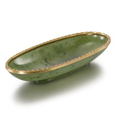 FROM THE ESTATE OF FRANCES H. JONES: A Fabergé Carved Nephrite Oval Dish with Gold and Enamel Mounts, Workmaster Michael Perchin, St. Petersburg, circa 1890, of narrow oval shape, the gold rim mount with alternating red translucent enamel ovals and oyster enamel dots, on a conforming carved oval foot.