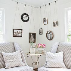 Yea, it's not all black rectangle frames.  Love this use of a corner.  Thanks foundbydomesticbliss.blogspot.com.