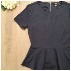 """NWT Navy peplum top NWT! So adorable. Full zip back. About 17.5"""" armpit to armpit measurement. Navy. 97 polyester/ 3 elastane Forever 21 Tops"""