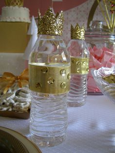 Pink and Gold Princess Party from My Princess Party to Go. Glitter crowns added to the top of water bottles with Gold Ribbon and Sequins make them fit for the Royal Guests. #pinkgoldparty
