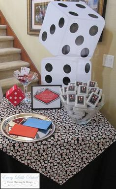 Casino night party favors -deck of cards customized. Large die statement decorations.