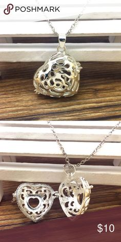 New Aromatherapy diffuser locket pendant necklace Silver colored heart pendant on a link chain. Comes with multi colired oil diffuser balls to place in the locket. Wear your favorite scented oil or ones for stress or focus tagless Jewelry Necklaces