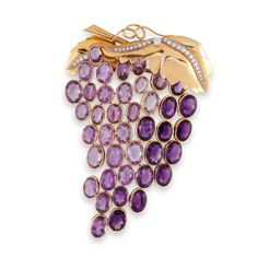 René Boivin Amethyst and Diamond 'Grappe de Raisin' Brooch Designed as a stylised bunch of grapes, the leaf surmount in yellow gold with brilliant-cut diamond detail, suspending an articulated series of collet-set facetted amethysts, circa 1950, French assay marks for gold and partial maker's mark for Leroy Chevrier Huot.