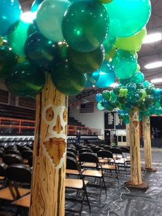 Balloon trees for a Wizard of Oz themed Homecoming Dance.