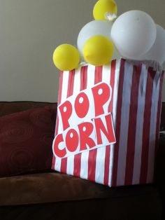 Giant Prop. Decoration - Popcorn Box Balloons. Got the idea on pinterest ;)  This was taken the day after the party and some balloons either deflated and/or kids pulled them off. lol