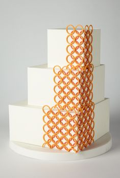 Brides: Square Wedding Cake with 3-D Details. We can totally see this pop-art creation at a gallery reception. Love the contrast of the square tiers and sugar-paste rings.