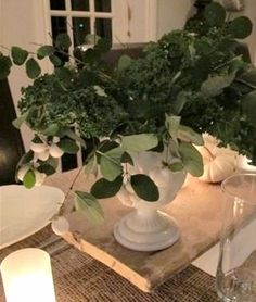 Centerpiece for thanksgiving with kale, and white berries