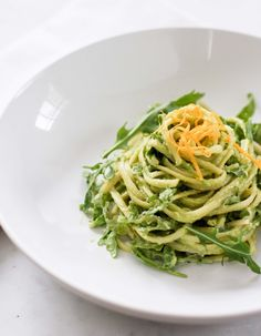 Creamy Avocado Linguine with Meyer Lemon and Arugula by sylvia fountaine, feasting at home blog. A creamy vegan pasta in a flavorful creamy avocado sauce, bursting with bright flavors of Meyer lemon, tossed with fresh arugula.