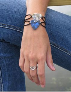 This guitar pick bracelet fits most; the band is pretty flexible. Works for both males and females! Fits comfortably to your wrist without sliding
