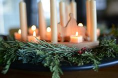 Love, Love, LOVE the idea of putting it on a large dish when we get down towards the end, and wrapping it in garland, with big candles and smaller ones. Love it. It has been the best advent wreath ever.