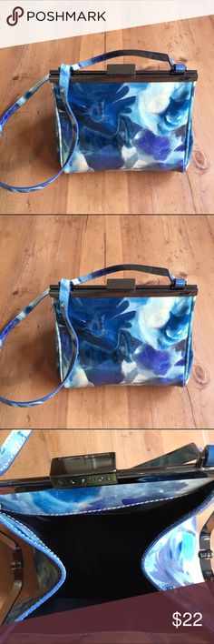 Via Spiga Bag ❤Host Pick ❤❤❤❤❤❤❤ 3/2 I love this bag. Great condition don't think it was ever used blue floral one side pocket inside 20 in long 6 1/2 in deep 7in wide so so cute Via Spiga Bags Shoulder Bags