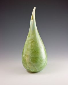 wheel thrown by mariespottery on Etsy. I love green, I love wheel thrown pottery, and I especially love the opening on this vase.
