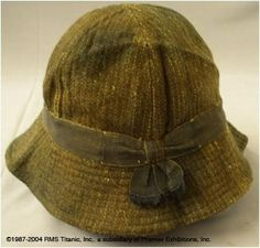 Passenger E.S. Andrew's Hat - This artifact was found folded into quarters inside a leather bag belonging to Titanic passenger Edgar Andrew. The hat, called a trilby, is made of wool with a silk inner lining.