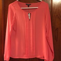 NWT Coral Chiffon Blouse by Express This is a NWT chiffon blouse from Express. It features front pleats and a v cut out. Elastic on cuffs of sleeves. Size XS. Express Tops Blouses