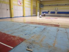Continue the complex phases of the removal of the sports flooring in stock at the sports hall of Riva del Garda